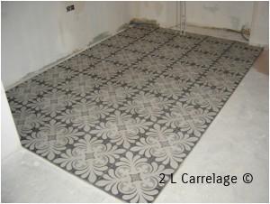 Pose sol de cuisine carreaux ciment. Pose d'un sol de cuisine en carreaux de ciment.